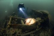 Divers explore the wreck of the Lake Edon, Newquay, Cornwall, UK