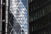 An abstract of 30 St Mary's Axe Tower, also known as the Gherkin, and the Lloyd's building. London, UK May 1st 2008
