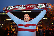 a West Ham United fan posing with a 'Farewell Boleyn' scarf outside Boleyn Ground during the 1st half. scenes around the Boleyn Ground, Upton Park in East London as West Ham United play their last ever game at the famous ground before their move to the Olympic Stadium next season. Barclays Premier league match, West Ham Utd v Man Utd at the Boleyn Ground in London on Tuesday 10th May 2016.<br /> pic by John Patrick Fletcher, Andrew Orchard sports photography.