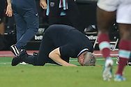 Marius Sumudica , the manager of Astra Giurgiu slumps on to his hands and knees after the final whistle as his team win the match. UEFA Europa league, 1st play off round match, 2nd leg, West Ham Utd v Astra Giurgiu at the London Stadium, Queen Elizabeth Olympic Park in London on Thursday 25th August 2016.<br /> pic by John Patrick Fletcher, Andrew Orchard sports photography.