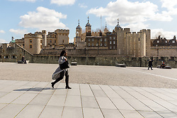 © Licensed to London News Pictures. 16/03/2020. London, UK. A very quiet and empty scene outside the Tower of London today which is normally busy with tourists at this time (11:50am). New cases and fatalities resulting from the COVID-19 strain of the Coronavirus continue to be reported daily in the UK with major sporting fixtures cancelled and people advised to stay at home if they have a cough and high temperature. Photo credit: Vickie Flores/LNP