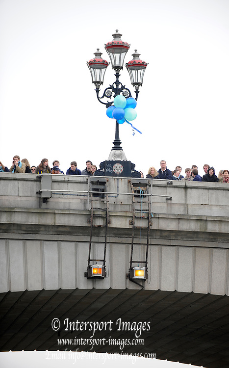 Putney. London.  Putney Bridge with Balloonss tied to the lamposts and spectators waiting for the 2011 University Boat Race over the  Championship Course - Putney to Mortlake.  Saturday 26/03/2011  [Mandatory Credit; Peter Spurrier/Intersport-images]