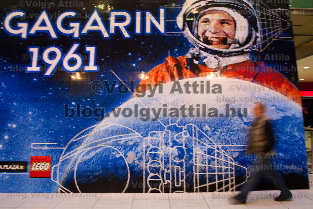 Visitor looks at world record breaker mosaic image of Russian astronaut Yuri Gagarin on display in a shopping center in Budapest, Hungary on March 27, 2011..The 30 square meters large mosaic image is made up from 470 016 Lego pieces and was built to celebrate the 50th anniversary of the first space flight. The national record is alredy validated and the international Guinness Record validation is in progress. ATTILA VOLGYI