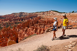 USA, Utah, couple hiking in morning light at Sunrise Point in Bryce Canyon National Park.
