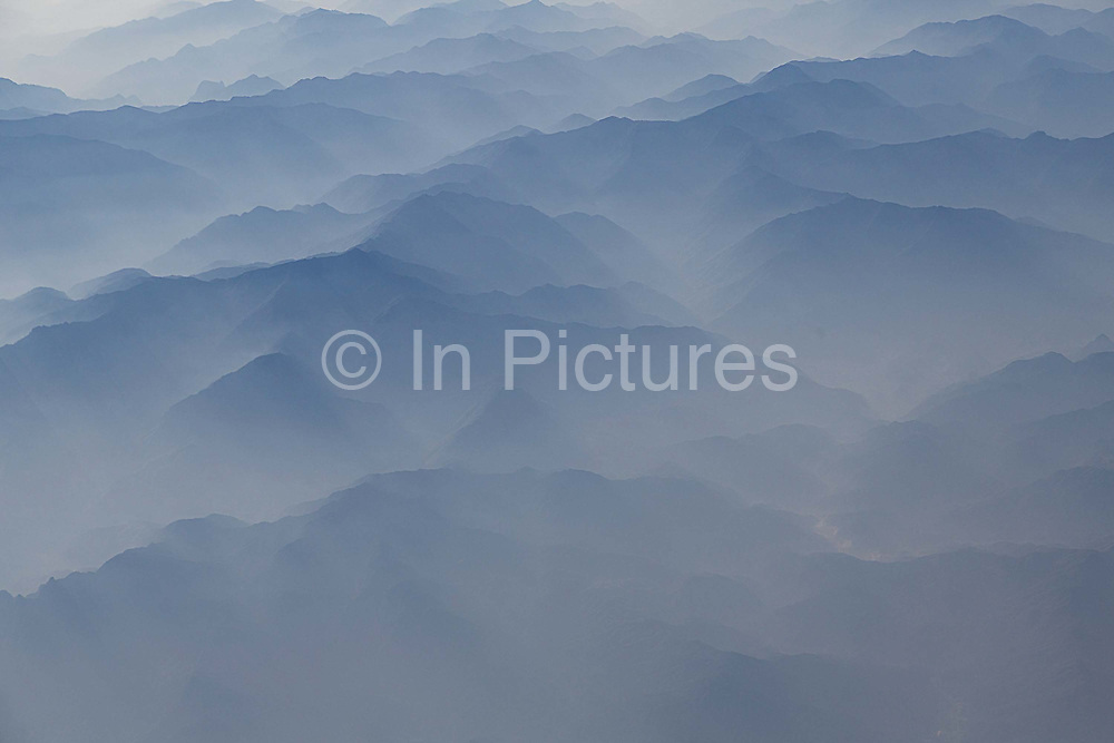 A heavy poisonous haze hang over the mountains of northern Guangdong Province in China on 5 December 2013.  Air pollution in China is seriously threathening the health of its citizens with level surpassing the upper limits  of measuring devices sometimes.