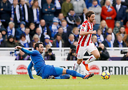 Stoke City's Joe Allen (right) and Leicester City's Vicente Iborra (left) battle for the ball