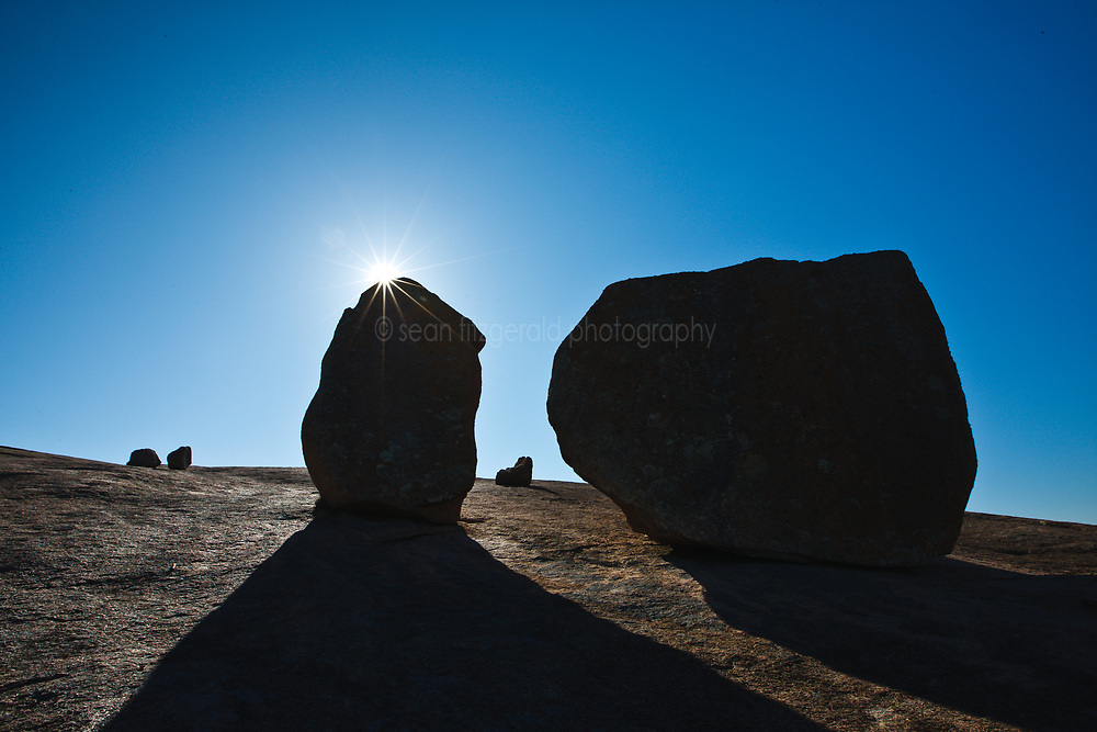 Landscape of backlit rocks, Enchanted Rock State Natural Area, near Fredericksburg, Texas in the Texas Hill Country, USA.