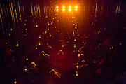 """An eerie orange glow surrounds the audience in this production of Samuel Beckett's radio play """"All That Fall."""""""