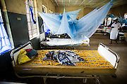 A child lies on a bed at the UBC hospital in Mattru Jong, Sierra Leone, on Tuesday April 20, 2010.