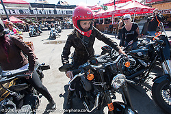 Leticia Cline of the Iron Lilies arrives at the Iron Horse Saloon after the Harley-Davidson Angels Ride to benefit the Nature Conservancy during the annual Sturgis Black Hills Motorcycle Rally.  SD, USA.  August 12, 2016.  Photography ©2016 Michael Lichter.