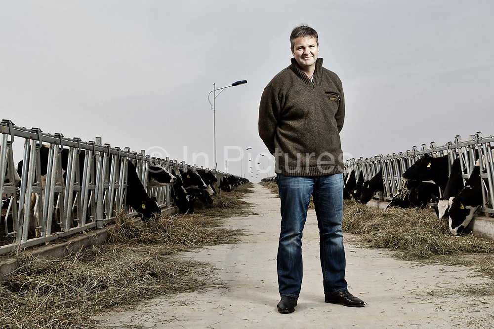 Edgar Collings, CEO of Austasia, poses for pictures while standing at his company's No. 4 dairy farm in Dongying, Shandong Province, China on 31 October, 2013. By the end of 2014, the pan-Asian diary group will have invested more than $US300 million in China and have around 55,000 cattle in its herd. The rapidly increasing dairy demand from China is pushing global prices higher, especially after food safety scandals have wrecked consumer confidence in local Chinese producers, spelling ample opportunity for global producers.