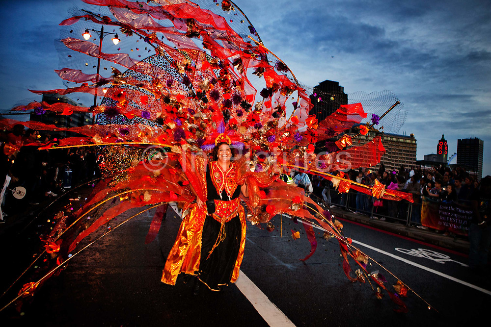 Samba dancers defying the rain in Britain's biggest and best illuminated night-time Carnival procession. The Night Carnival is made up of 2,000 dancers, drummers, lantern-carriers†and costumed masqueraders..The Thames Festival celebrates London and the iconic river at its heart - the Thames - by dancing in the streets, feasting on bridges, racing on the river and playing at the water's edge..