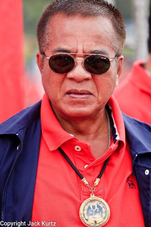 """26 MARCH 2009 -- BANGKOK, THAILAND: Veera Musigapong, a leader of the United Front of Democracy Against Dictatorship (UDD), waits to speak at a UDD rally in Bangkok. More than 30,000 members of the United Front of Democracy Against Dictatorship (UDD), also known as the """"Red Shirts""""  and their supporters gathered on Sanam Luang (the vast open field in front of the Palace) and descended on central Bangkok March 26 to start a series of protests against and demand the resignation of current Thai Prime Minister Abhisit Vejjajiva and his government. The protest is a continuation of protests the Red Shirts have been holding across Thailand. Thaksin was deposed in a coup and went into exile rather than go to prison after being convicted on corruption charges. He is still enormously popular in rural Thailand.  PHOTO BY JACK KURTZ"""