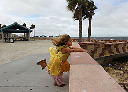 October 7, 2016 - Hudson, Florida, U.S. - KALISEE LYNN BEDWELL, 3, enjoys the gusts of wind as an outer band from Hurricane Matthew moves across Hudson Beach in Pasco County Friday morning. Bedwell visited the beach with her father Sherman (Bedwell), of Hudson, to check out the incoming weather. (Credit Image: © Brendan Fitterer/Tampa Bay Times via ZUMA Wire)