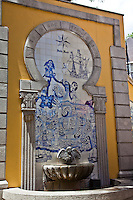 Street fountain in the historic streets of Macau.