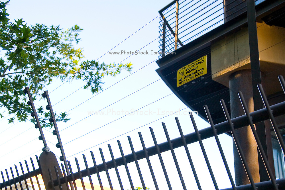 South Africa, Johannesburg, Electric fences walls and barbed wire surrounding houses