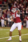 Nov 5, 2011; Fayetteville, AR, USA;  Arkansas Razorback defensive end Jake Bequette (91) reacts to a sac during the first half of a game against the South Carolina Gamecocks at Donald W. Reynolds Stadium.  Mandatory Credit: Beth Hall-US PRESSWIRE