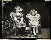 Monochrome magic lantern slide family portrait of two young girls presumably sisters circa 1900