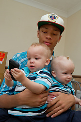 Small twin boys with older brother. (This photo has extra clearance covering Homelessness, Mental Health Issues, Bullying, Education and Exclusion, as well as the usual clearance for Fostering & Adoption and general Social Services contexts,)