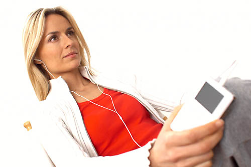 woman listening to an ipod, mp3 player<br />