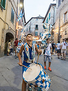 Italy, Siena, the Palio: supporters of the contrada celebrates in the streets , heading to the contrada where people are waiting for the Palio arrival from thr Duomo.