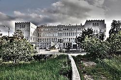 """Il seminario di Ostuni si iniziò a costruire nel 1700 per volere del vescovo Benedetto Milazzi (1679-1706); lo ricorda anche l'epigrafe che è sulla facciata prospettante largo Trinchera. <br /> Danneggiato del sisma del 1743, l'edificio fu ricostruito per l'iniziativa del vescovo Francesco Antonio Scoppa (1747-82) tra il 1747-48 su progetto del maestro Salvatore Trinchera. <br /> Dal 1975 al 2007 il seminario ha avuto la sua sede, dopo esser nuovamente ritornato a Brindisi, presso l'Istituto """"Madonna Pellegrina. <br /> Tale struttura era stata costruita da Mons. Italo Pignatelli come """"Scuola di arte muraria"""""""