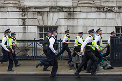 © Licensed to London News Pictures.  18/06/2021. London, UK. Police are seen chasing English football supporters along White Hall, central London ahead of their EURO 2020 match against England at Wembley this evening. Photo credit: Marcin Nowak/LNP