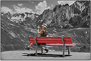 Day Tripper - Alpine Travels is a selective colour street photography series by photographer Paul Williams taken in 2008 taken at Grindlewald First ski station showing a tourist enjoying the high mountains of the Alps. .<br /> <br /> Visit our REPORTAGE & STREET PEOPLE PHOTO ART PRINT COLLECTIONS for more wall art photos to browse https://funkystock.photoshelter.com/gallery-collection/People-Photo-art-Prints-by-Photographer-Paul-Williams/C0000g1LA1LacMD8