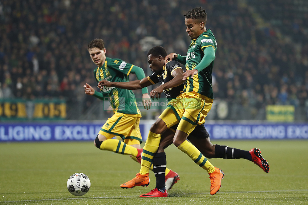 (L-R) Danny Bakker of ADO Den Haag, Thomas Agyepong of NAC Breda, Tyronne Ebuehi of ADO Den Haag during the Dutch Eredivisie match between ADO Den Haag and NAC Breda at Cars Jeans stadium on March 10, 2018 in The Hague, The Netherlands