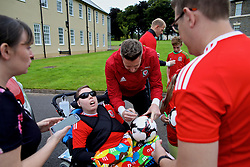 CARDIFF, WALES - Tuesday, August 29, 2017: Wales' goalkeeper Wayne Hennessey signs a football for a supporter before a training session at the Vale Resort ahead of the 2018 FIFA World Cup Qualifying Group D match against Austria. (Pic by David Rawcliffe/Propaganda)