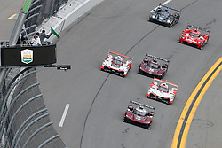 January 26, 2019 - Daytona, FL, U.S. - DAYTONA, FL - JANUARY 26: The green flag waves at the start of the Rolex 24 at Daytona on January 26, 2019 at Daytona International Speedway in Daytona Beach, Fl. (Photo by David Rosenblum/Icon Sportswire) (Credit Image: © David Rosenblum/Icon SMI via ZUMA Press)