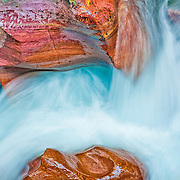 Glacial blue rushing water highlights striated colored rocks at Avalanche Gorge, Glacier National Park, northwestern Montana.<br /> <br /> Highly Commended for Photographic Excellence in Denver Audubon Society's Share the View 2014 international competition, and semifinalist in North American Nature Photography Association 2015 Showcase competition. Earth Shots Photo of the Day on December 30, 2015.