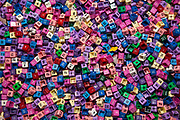 Hundreds of plastic clothes tags, showing all the sizes and different colour codings.