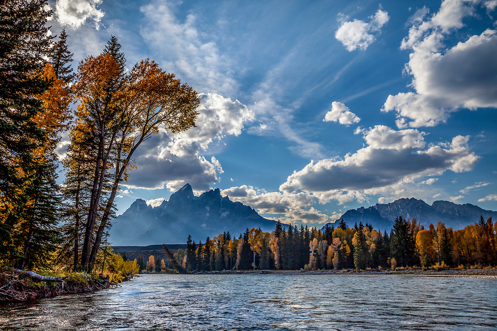 Waters edge view from a raft on the Snake River with the Teton Mountain Range in Teton National Forest on beautiful calm autumn morning. Licensing and Open Editions