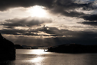 Norway, Stokksund. Sunrays above Stokken.