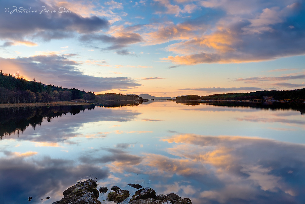 Peaceful, mirroring lake surface of Lough Currane near Waterville, County Kerry, Ireland along the Wild Atlantic Way and the Skellig Coast<br /> <br /> Image code: wv059