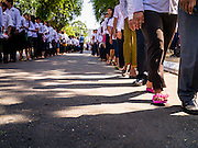 02 FEBRUARY 2013 - PHNOM PENH, CAMBODIA:  People wait in line to see the crematorium of King Norodom Sihanouk during the mourning period for Sihanouk, who ruled Cambodia from independence in 1953 until he was overthrown by a military coup in 1970. Sihanouk died in Beijing, China, in October 2012.       PHOTO BY JACK KURTZ