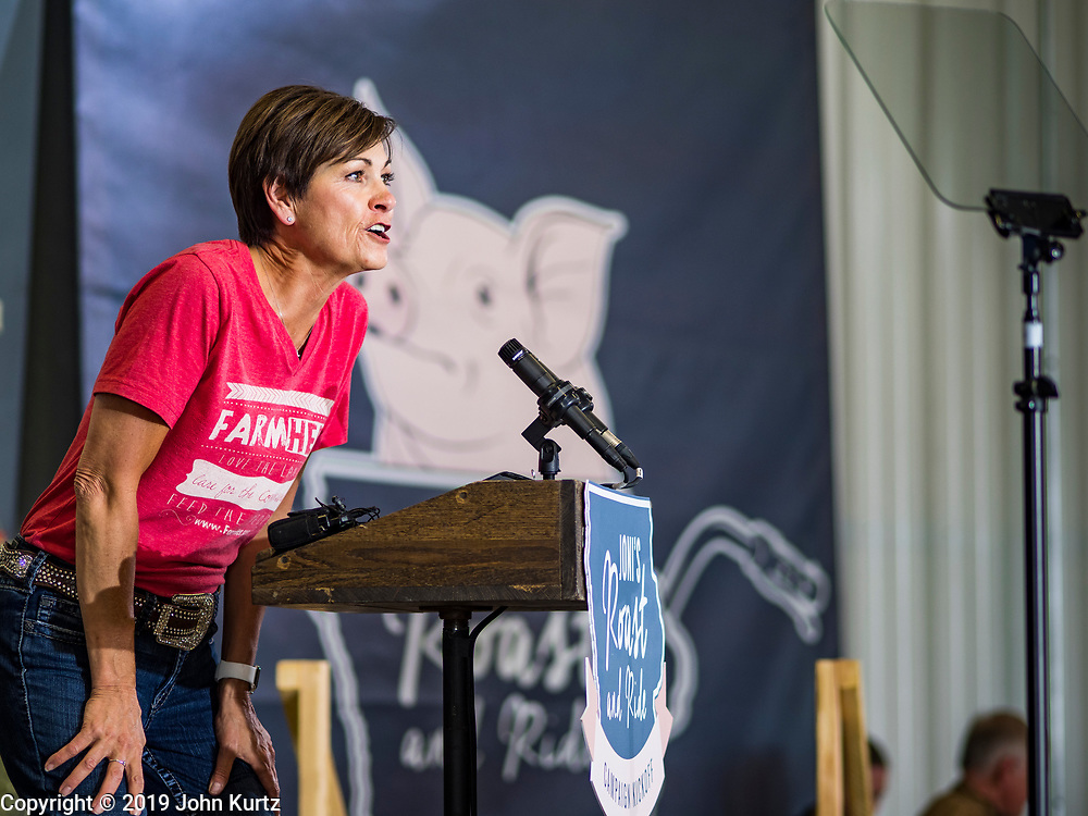 """15 JUNE 2019 - BOONE, IOWA: Governor KIM REYNOLDS (R-IA), speaks on behalf of US Senator Joni Ernst, (R-IA) during """"Joni's Roast and Ride,"""" an annual motorcycle ride / barbecue fund raiser hosted by Ernst. Ernst, Iowa's junior US Senator, kicked off her re-election campaign during the """"Roast and Ride"""", an annual fund raiser and campaign event has she held since originally being elected to the US Senate in 2014.   PHOTO BY JACK KURTZ"""