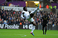 Swansea city's Wilfried Bony attempts a spectacular overhead shot at goal. Barclays Premier league, Swansea city v Manchester City at the Liberty Stadium in Swansea,  South Wales on  New years day Wed 1st Jan 2014 <br /> pic by Andrew Orchard, Andrew Orchard sports photography.