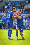 Cardiff City midfielder Marlon Pack (21) with team-mate Kieffer More (10) during the EFL Sky Bet Championship match between Cardiff City and Bristol City at the Cardiff City Stadium, Cardiff, Wales on 28 August 2021.