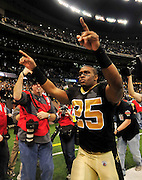 NFL Saints - New Orleans Saints RB (25) Reggie Bush celebrates as he walks off the field after beating the Arizona Cardinals in the NFC Playoffs in the SuperDome in Louisiana Sat. Jan. 16,2010. The Saints beat the Cardinals to advance in the playoffs. Photo ©Suzi Altman/Suzisnaps.com