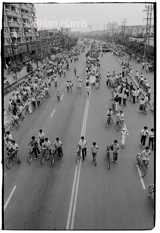 China Shanghai a few days after the massacre in Tiananmen Square in June 1989. Scans made in 2018<br /> Students march through the centre of Shabghai in protest at the deaths of their fellow students in Beijing a few days earlier
