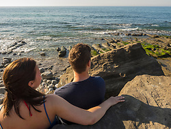 Young couple on the beach drinking white wine, Beach of Azkorri, Getxo, Biscay, Spain
