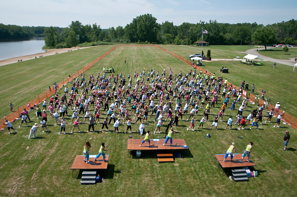 Matt Dixon   The Flint Journal..Hundreds gathered at Bluebell Beach in Flint Saturday morning to attempt to break the record for most people at a zumba class. Over 1200 participants were needed to break the record.