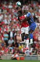 Photo: Lee Earle.<br /> Arsenal v Portsmouth. The FA Barclays Premiership. 02/09/2007.Arsenal's Emmanuel Adebayor (L) clashes with Noe Pamarot.