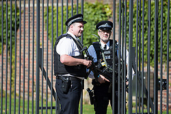 © Licensed to London News Pictures. 31/08/2017. London, UK. Armed police watch over the gates to Kensington Palace in London on the 20th anniversary of the death of Diana, Princess of Wales. Princess Diana was fatally injured in a car crash along with her companion Dodi Fayed, while the couple were being driven through the Pont de l'Alma tunnel in Paris on 31 August 1997. Photo credit: Ben Cawthra/LNP