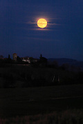 full moon with village on a hill top in France Languedoc