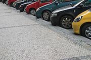 Cars parked along a pavement. Prague, Czech Republic, 2006