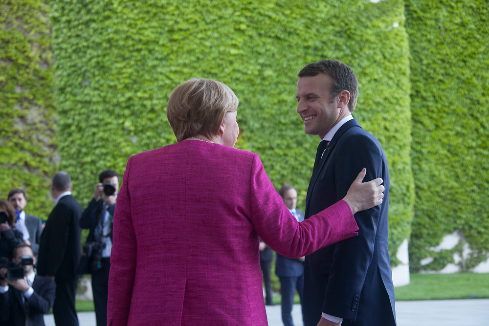 The German Chancellor Angela Merkel (L), and the French President Emmanuel Macron (R) are seen at the chancellery in Berlin, as part of Macron first official visit as President to Germany, on  Monday, May 15, 2017. (Photo by Omer Messinger)