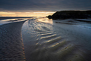 We trudged through soft wet sand towards the coast, and apart from one couple passing us on their way back to the lane, we found ourselves alone on an empty beach. <br />